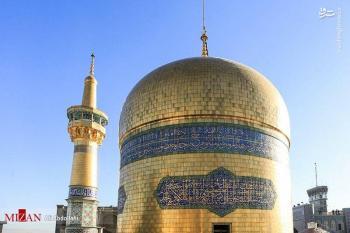 پرچم سبز روی گنبد حرم امام رضا(ع) +عکس