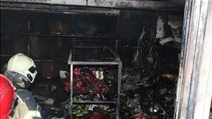 نجات مادر و دو فرزندش از میان شعله های آتش در پیتزا فروشی