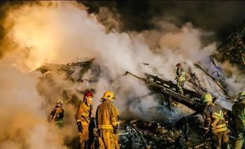 کشف ۲ کپسول آتشنشانی از زیر آوار