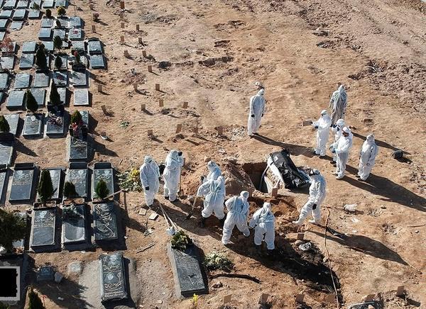 عکس ناراحت کننده از دفن یک کرونایی